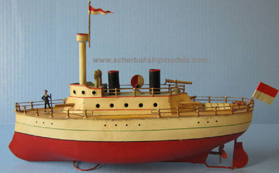 Carette toy tin clockwork gun boat 14.5in long.jpg