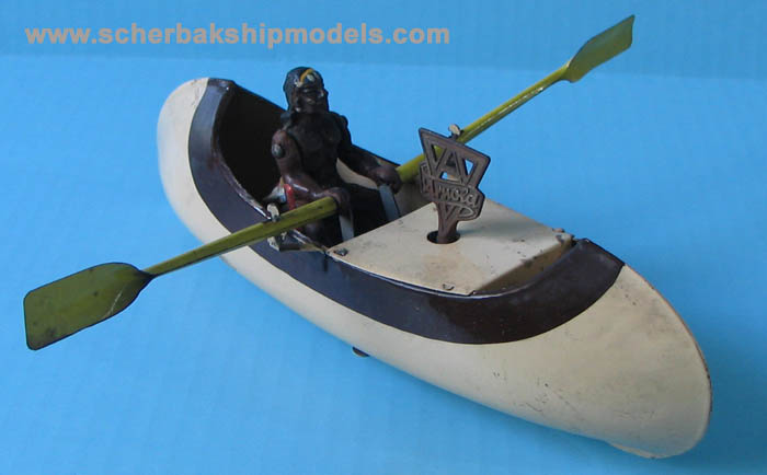 arnold rowing canoe tin boat clockwork.jpg